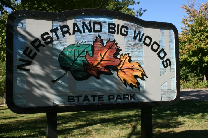 The sign welcoming visitors to Nerstrand Big Woods State Park, known for its beautiful fall colors.