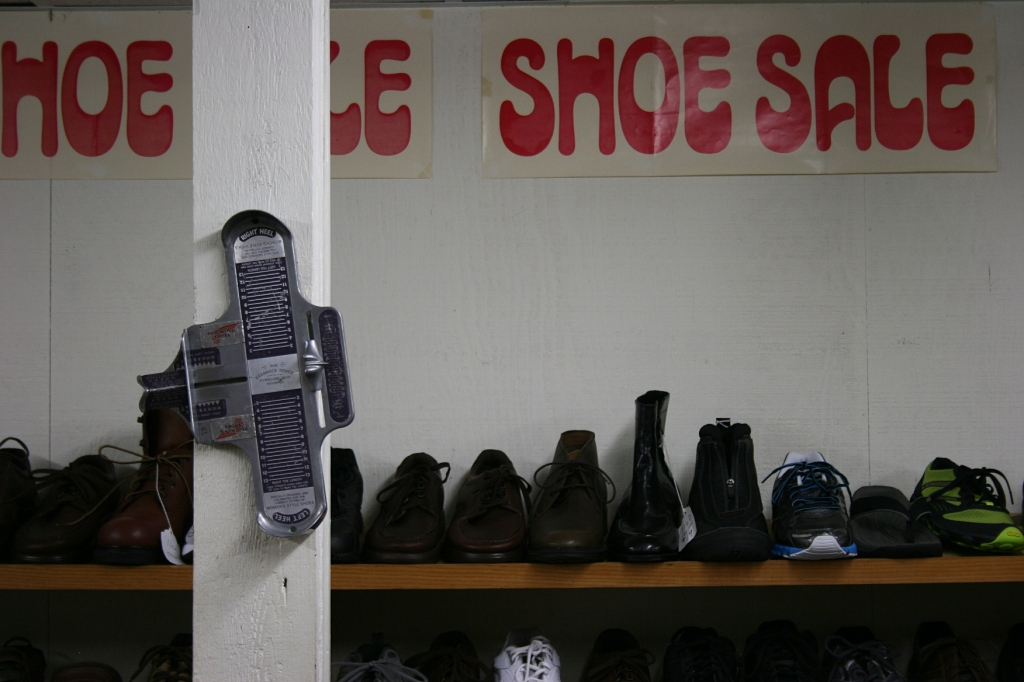 A shoe sale in the back room in the basement.
