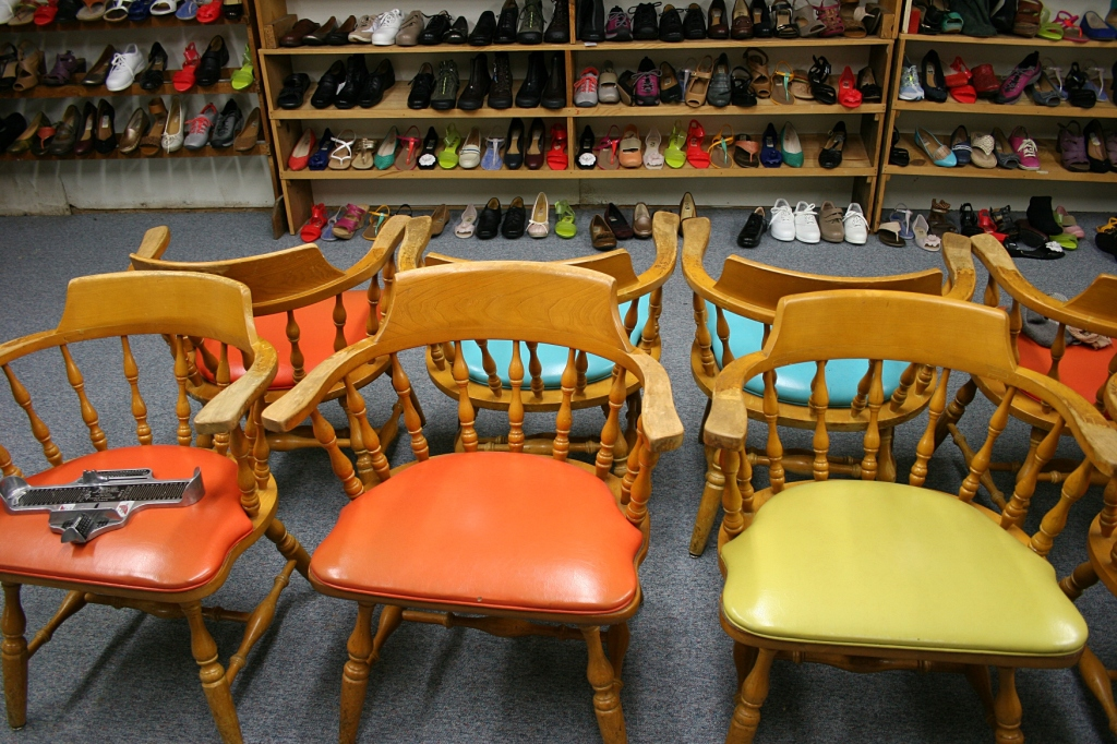 Colorful vintage chairs in the basement.