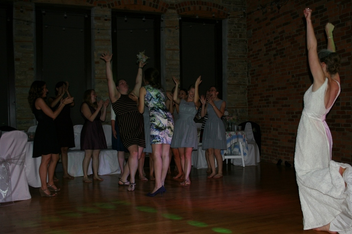The single ladies celebrate after one of them catches the bouquet.