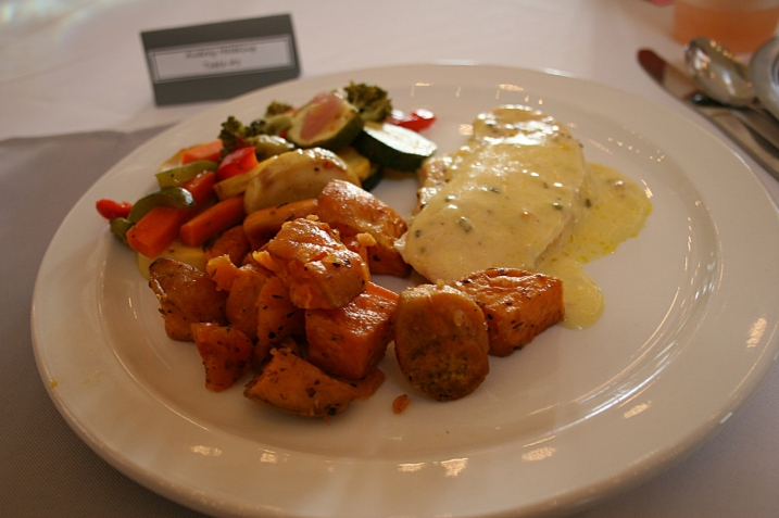 Faribault based Arna Farmer Catering catered the meal of chicken breast in white wine sauce, roasted sweet potatoes and a mixed vegetable medley. Dessert of apple crisp and bars was served later. There was no wedding cake.