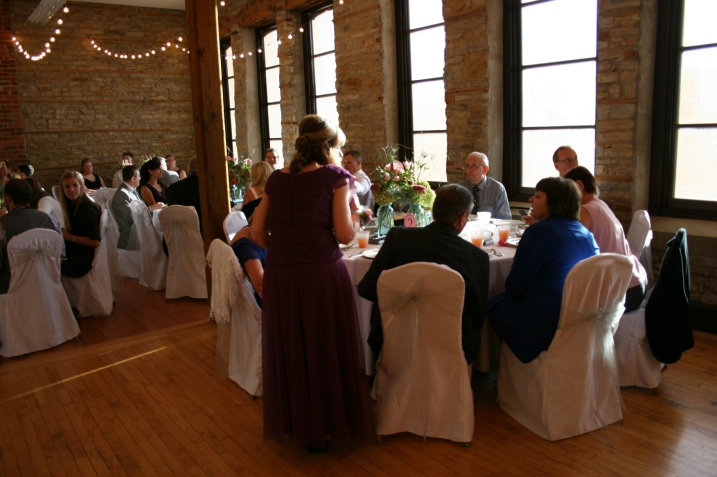 Eleven round tables, which will seat up to 10, filled the reception space. The groom's parents and grandparents and other family members were seated at the table in the foreground.