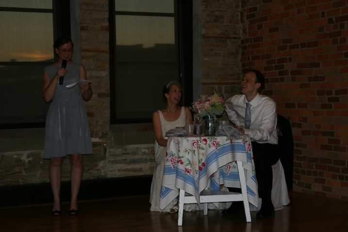 The bride's sister and maid of honor, Miranda, speaks and toasts the couple.