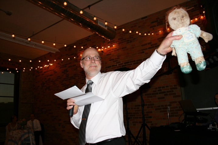 My husband and I agreed that he should use several props to make his speech memorable. Here he pulls out Amber's favorite childhood doll, Sal, whom she dragged everywhere. Randy introduced the groom to Sal before handing over Amber's treasured doll.
