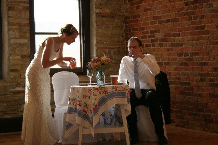 Beautiful natural light filters in through west facing windows as the newlyweds settle in at their sweetheart table.