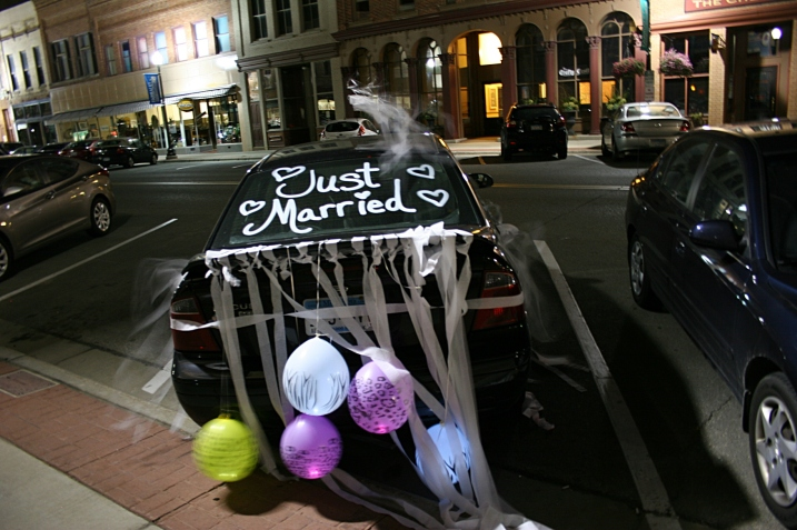 The couple's car, decorated and parked along Central Avenue in historic downtown Faribault, across the street from the reception venue, The Loft in the Bachrach Building.