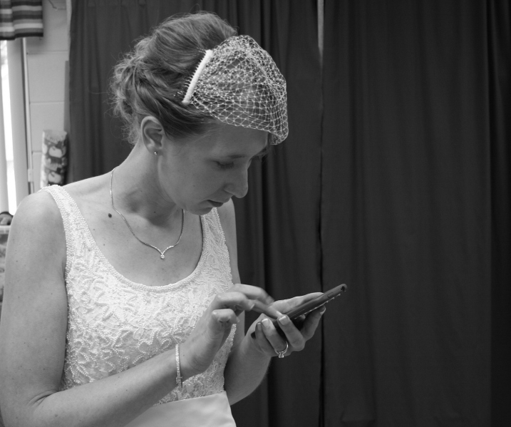 And back in the changing room, the bride uses her smart phone.