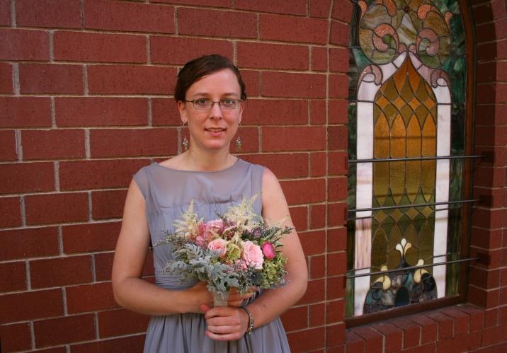Sister of the bride and maid of honor, Miranda.