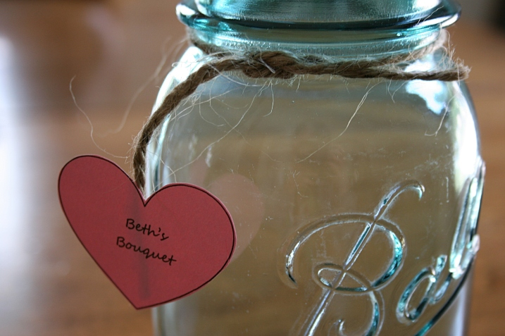 Vintage blue canning jars have been rented and readied for bridal party and table bouquets.