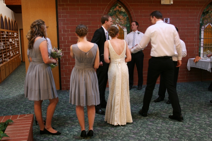 The bridal party awaits the beginning of their photo shoot.