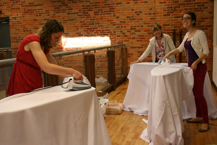 The ironing crew, from left, maid-of-honor Miranda (the bride's sister), Lynn (mother of the groom) and Stephani (sister-in-law of the groom and reader). Ironing was, by far, the biggest and longest task. I ironed all of the sashes and napkins prior to set up day, so did little ironing of tablecloths.