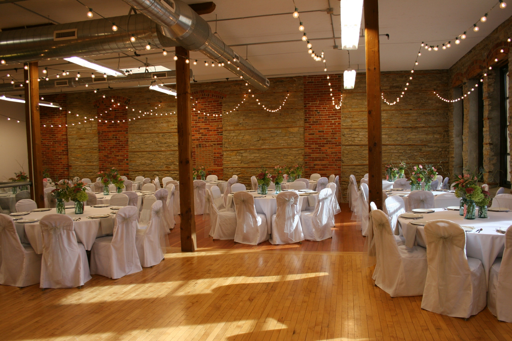 One Last View Of The Reception Venue With A Space Left Open For Dance Floor