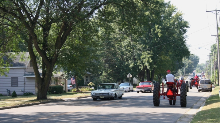 Mid-morning Saturday, while I was watering my flowers, a mini tractorcade puttered past my Faribault home. By the time I realized what I was seeing and retrieved my camera from my office, I