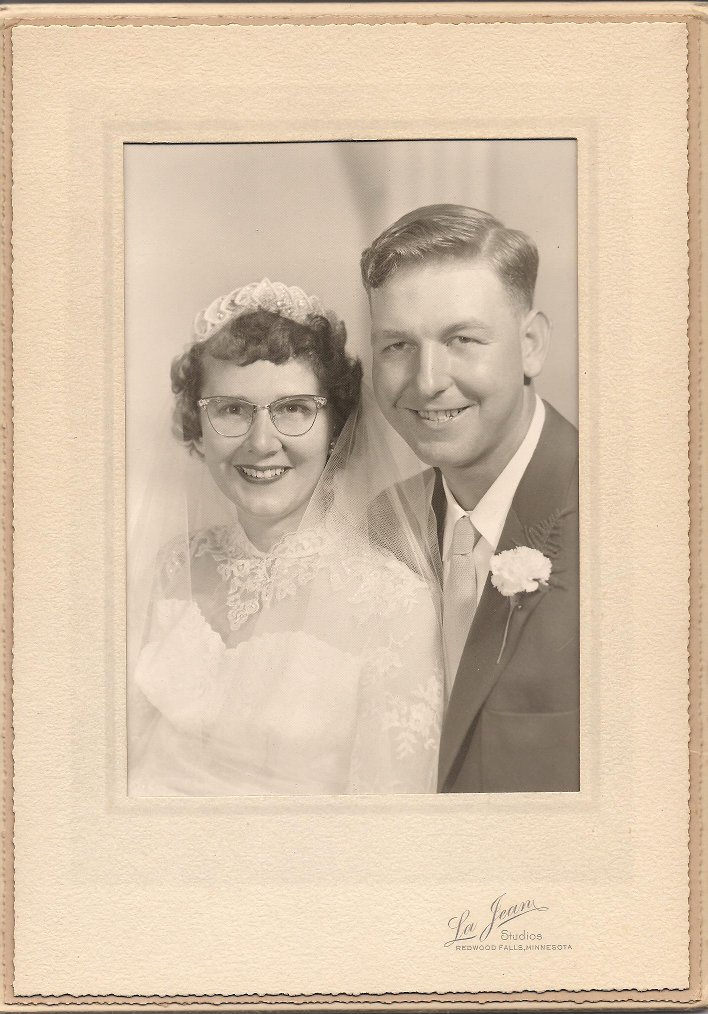 Amber and Marc wanted to honor their parents and grandparents at their wedding reception and did so with wedding day portraits, like this of my parents, Elvern and Arlene, married on September 25, 1954.
