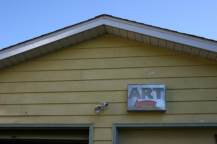 An art sign hangs above metal artist Julie Wolcott's garage-shop, rural Northfield.