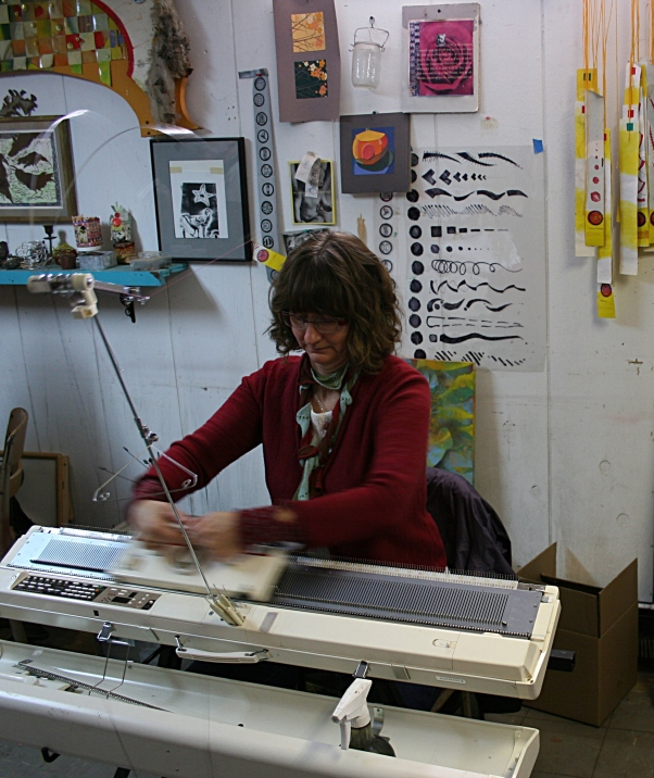 Artist Ian Baldry of St. Louis Park creates a scarf on her knitting machine.