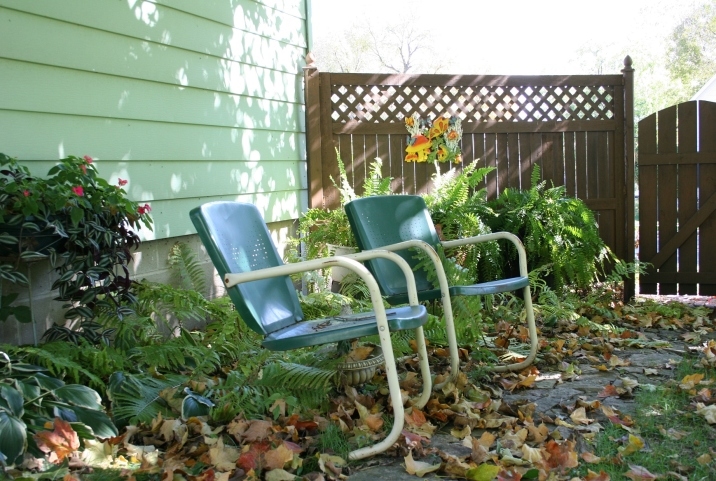 A favorite part of my backyard, vintage lawn chairs along a limestone pathway now covered with leaves.