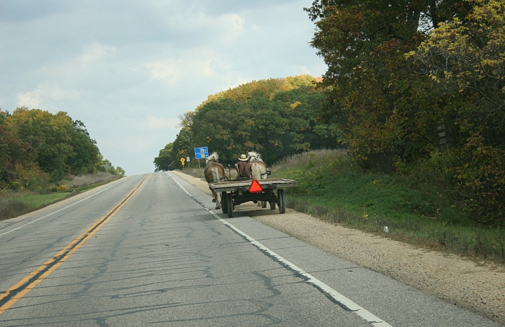 An Amish man traveling Wisconsin State Highway 21 on Friday, October 11, 2013.