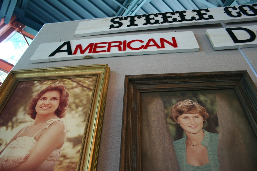 The Princess Kay of the Milky Way competition is a part of Minnesota culture. The Steele County exhibit features  photos of past county dairy royalty, including 1978 princess Kari Schroht, left, and 1976 princess Kathy Zeman, right. Earlier carved butter heads from past princesses were displayed in borrowed glass door freezers at the history center.