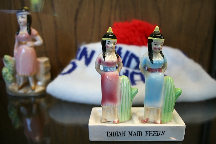 Indian Maid Feeds memorabilia is displayed in glass cases along with an impressive collection of butter molds and other items.