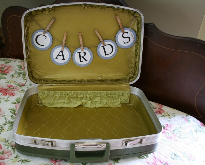 And then the jute string of letters was hot glue gunned inside the bride's dad's vintage 1970s suitcase.