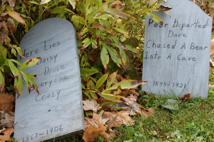 Among the humorous tombstones on display.