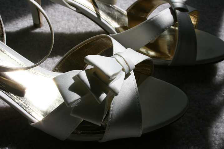 """When Amber initially chose plain navy blue pumps to wear with her wedding gown, I had to zip my lips, sort of. They were her """"something blue,"""" but I thought the wrong choice. I said something like """"just make sure they don't show in photos."""" Eventually she changed her mind and chose these lovely bow-detailed and classy shoes. She had her toenails painted blue for the """"something blue."""""""