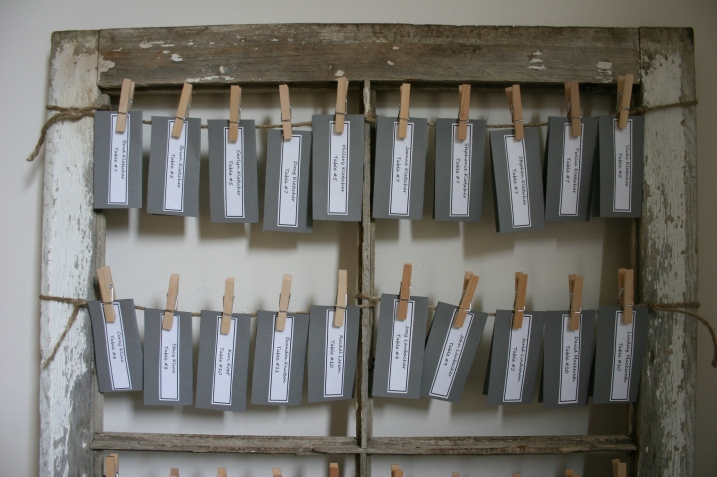 Name cards that the bride and groom created were attached to the old barn windows via jute and clothespins.