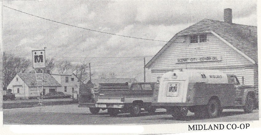 My uncle's gas station with the fuel delivery truck parked by The Old Log Cabin. Photo from Envisioning a Century, Vesta, 1900-2000.
