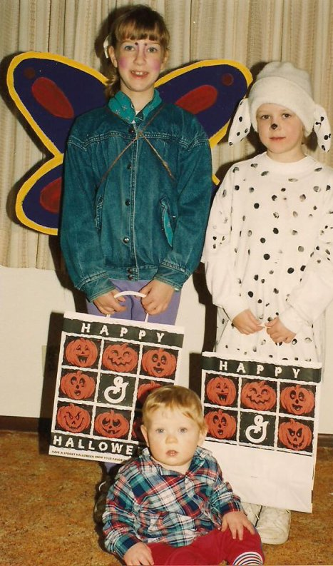 In 1994, my daughters, Amber, left, and Miranda, right, dressed as a butterfly and Dalmatian respectively. Their 10-month-old brother, Caleb, was too young to go trick-or-treating.