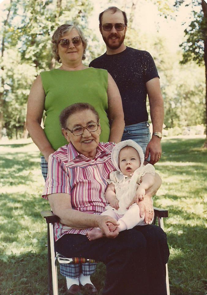 Four generations: Great Grandma Katherine Simon holding my daughter, Amber, with my mother-in-law behind them beside my husband, Randy. Photo taken in July 1986 at a family picnic, Pierz, Minnesota.
