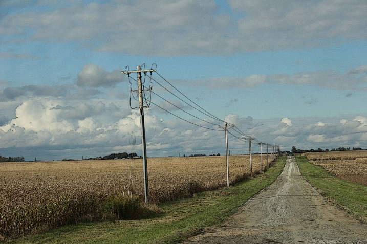 Strong lines pull me in, lead me to wonder where that gravel road would take me.