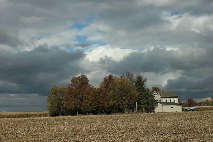I see here trees huddled, protecting and sheltering that house from the elements. My thoughts turn introspective at this scene.