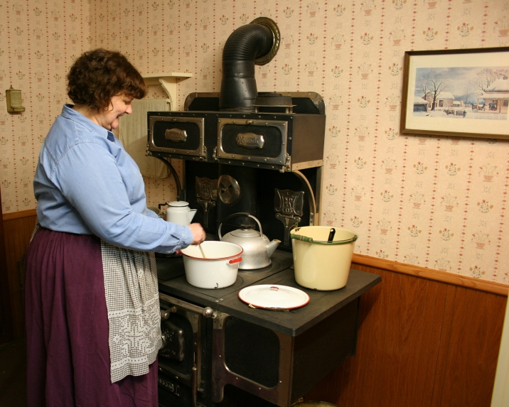 Mrs. Morris supposedly cooking applesauce.