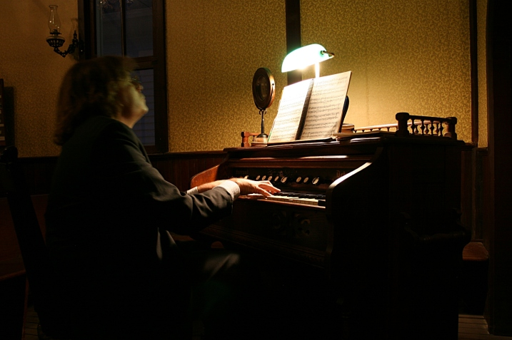 Playing the old pump organ.