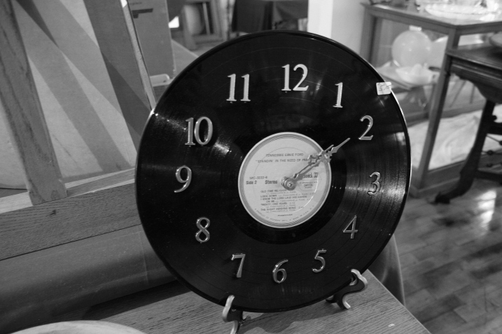 Oh, how I wish I had bought this clock, crafted by Don's mom (recently deceased) from an old album.