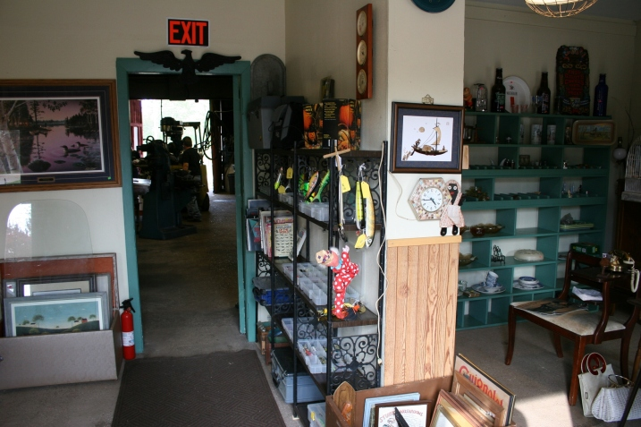 Madre's Antiques is in the front of the building and Mike's machine shop through the doorway into the larger back space.