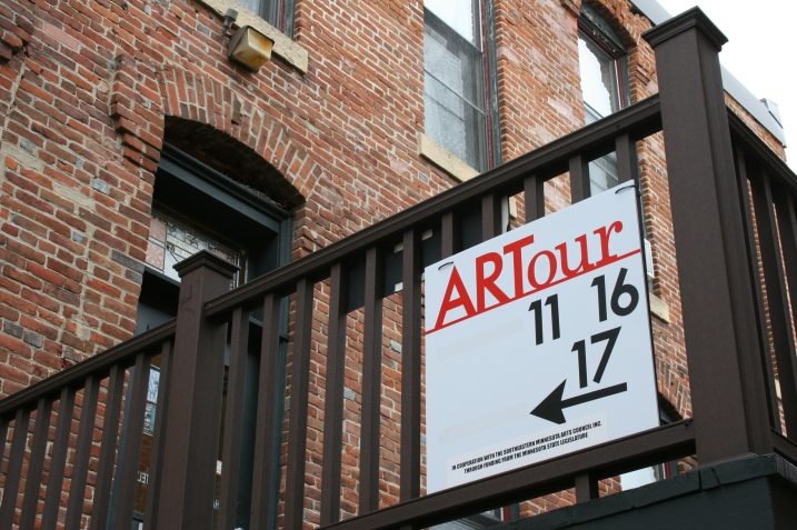 Signage directs visitors toward art studios on the third floor of an historic downtown Northfield building along East Fifth Street.