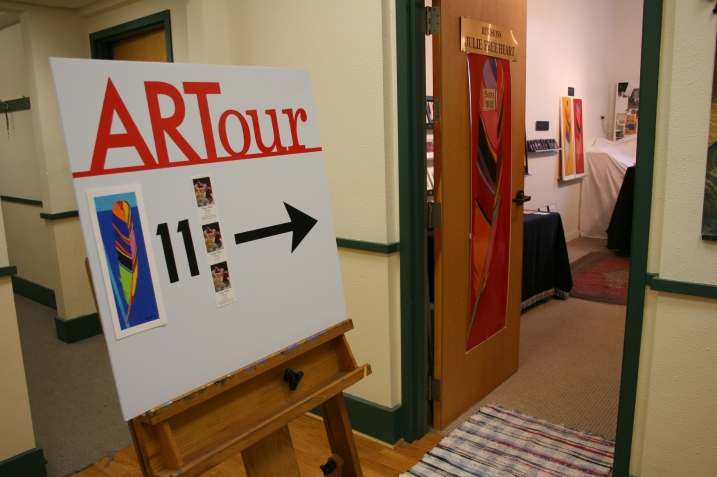 A sign directs visitors to Julie Free Heart's Revisions studio.