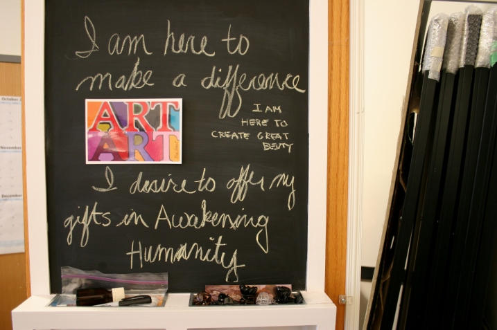 A message chalked on the back of Free Heart's studio door shares her philosophy on art.