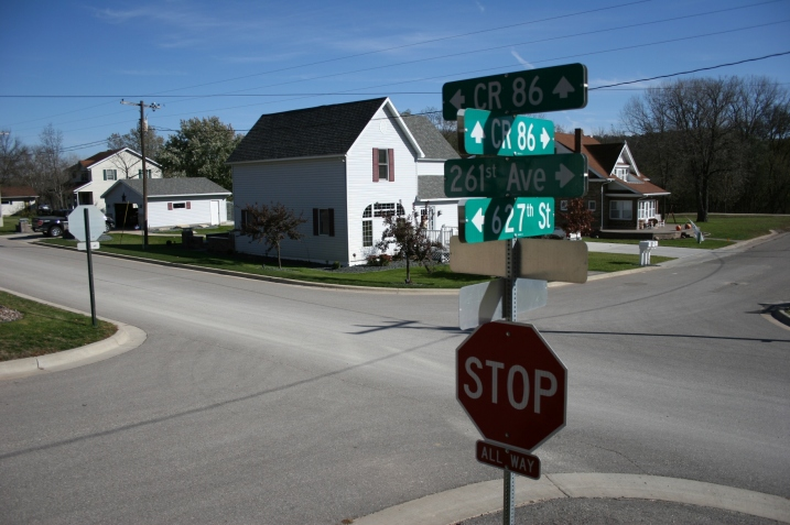Well kept homes and a small playground/park border one side of the main drag, where I spotted this mass of signage on the corner by St. Joseph's Catholic  Church.