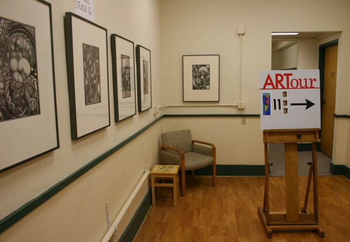 Maryrose's graphite drawings showcased in a hallway.