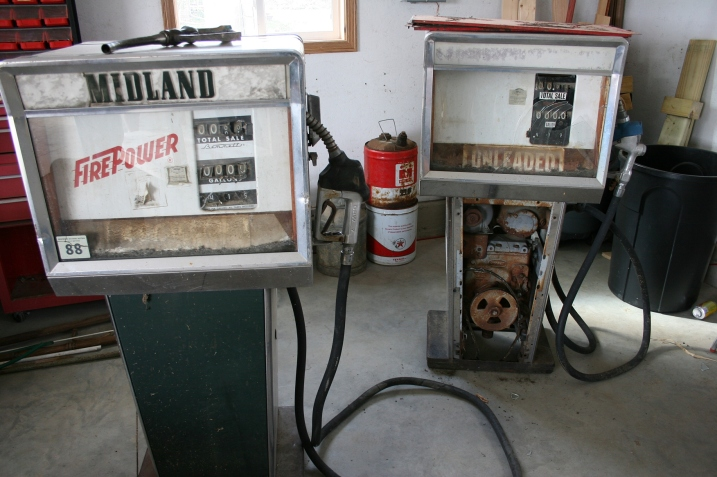 The vintage Midland gas pumps purchased by my Uncle Milan at the gas station auction. My brother Brian recently bought the pumps from Milan with plans to restore them.