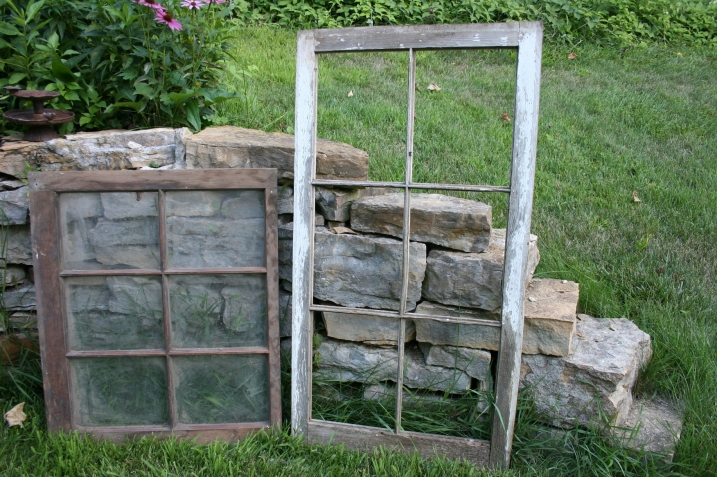 First the bride considered using old picture frames to hold guests' seating place cards. But then I remembered two old barn window frames stashed in our garage. One came from the Helbling family farm, where my husband grew up, and the other from my childhood farm. Perfect.