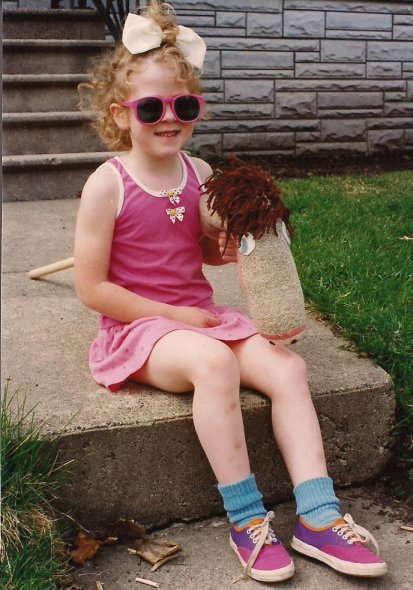 As a little girl, Miranda was all girly girl, wearing only skirts and donning ribbons in her hair. She also loved horses, including her stick horse, shown here in a photo taken when she was 5 1/2.