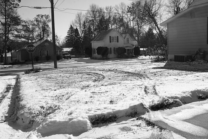 That's the corner of my house on the right with the vehicle tracks in the snow nearly half way into my side yard.