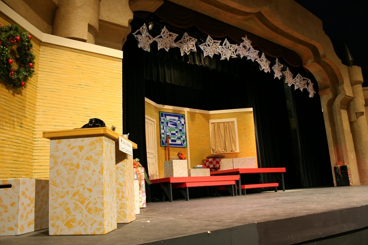 The sets are constantly changing in the performance. This set shows the Macy's Department Store desk of Doris Walker (Sydney Place-Sallstrom), left, and Doris and Susan Walker's apartment, center stage.