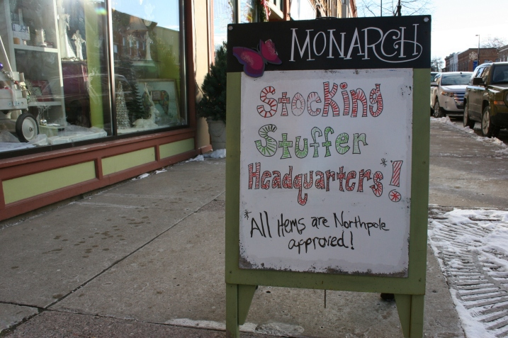 Detailed holiday signage draws shoppers into businesses.