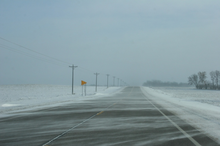 Strong winds drift snow across U.S. Highway 14 east of Lamberton this morning.