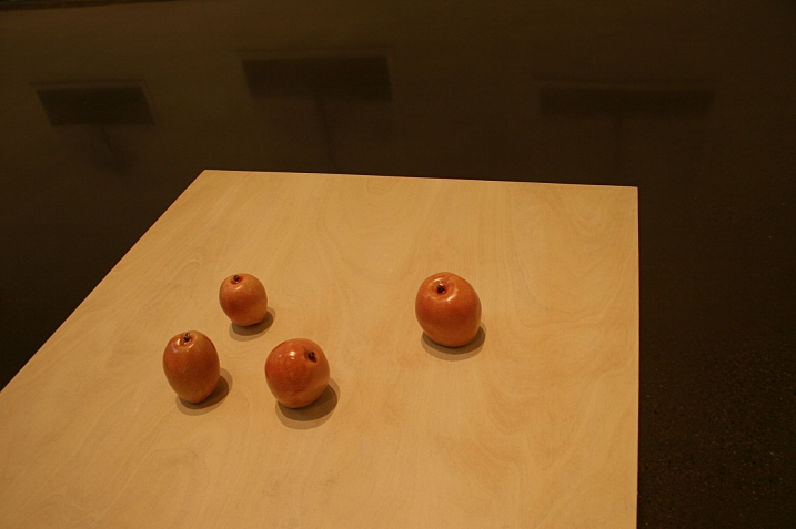 I love the simplicity of the apples positioned on the table in Rath's exhibit and how the shadows angle onto the tabletop.